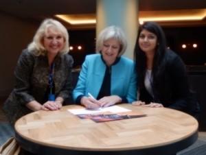 With Home Secretary Theresa May